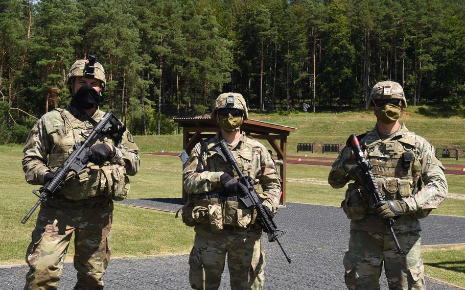 From left, First Lt.Jeremy Lahn, a health services officer with the 30th Medical Brigade, Pfc. Griffin Emrick, a combat medical specialist with the Joint Multinational Readiness Center, and Sgt. Jason Sauer, a chemical, biological, radiological and nuclear specialist with the 41st Field Artillery Brigade, gather during the U.S. Army Europe, Best Warrior Competition on July 27, 2020, at Hohenfels, Germany.
