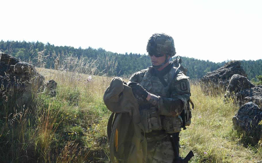 First Lt. Jeremy Lahn, a health services officer with the 30th Medical Brigade, participates in a medical evacuation exercise on July 28, 2020, during the Best Warrior Competition in Hohenfels, Germany.