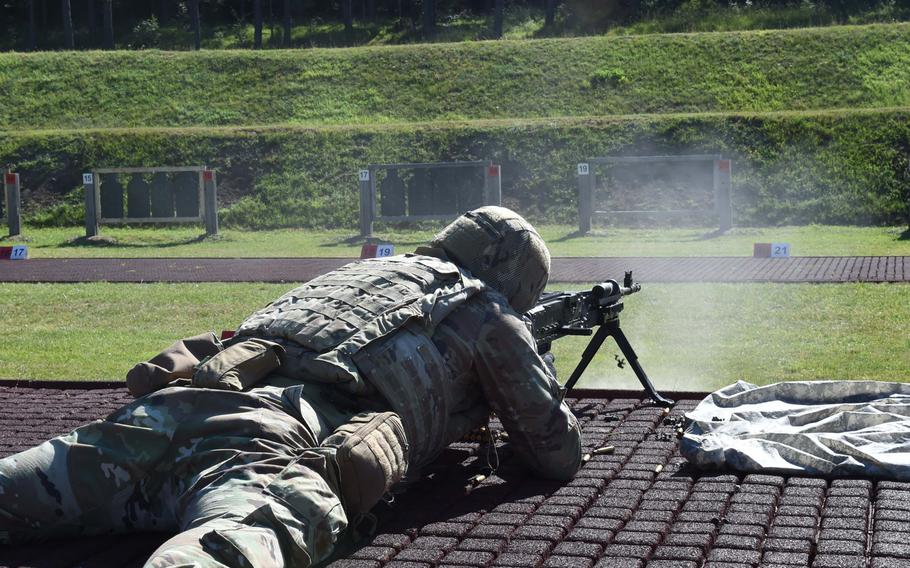 Staff Sgt. William McLain, an explosive ordnance disposal specialist with the 16th Sustainment Brigade, fires at a range on July 28, 2020, during the Best Warrior Competition in Hohenfels, Germany.