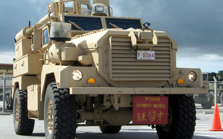 Nineteen MRAPS arrived on Okinawa in May, and Marines began training with them on Camp Hansen in October.