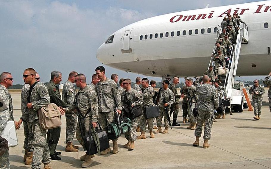 Members of the Vermont National Guard and members of Task Force Saber arrive in Gulfport, Miss., Tuesday, June 13, 2006. Vermont Guard officials want to get the soldiers home as soon as possible, but the return schedule will depend on how long it takes to get the entire 400-member unit processed at Camp Shelby, Miss., said Guard spokesman Capt. Jeff Roosevelt.