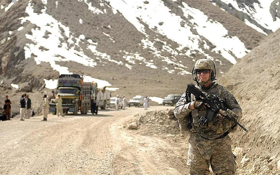 In this March 17, 2010 photo released by the U.S. Army, Army Sgt. 1st Class Thomas Snipp of Morrisville, Vt., a member of the Vermont National Guard 172nd Infantry Division, 3rd Battalion, Echo Company, Distribution Platoon, stands watch during a convoy rest stop in the Paktya province, Afghanistan. Soldiers from the Vermont National Guard company are working in the field in Afghanistan. Less than a week after arriving, soldiers from the distribution company of the Morrisville-based Echo Company are helping move supplies across eastern Afghanistan.