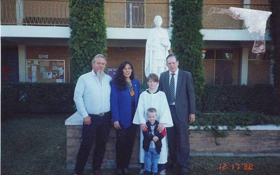 Jonathan with his parents, grandfather and nephew at his Catholic confirmation at the St. Louis the King Catholic Church, which held the funeral services after Jonathan's suicide. Teachers from the church's school, which both Jonathan and his mom attended, were at the funeral.