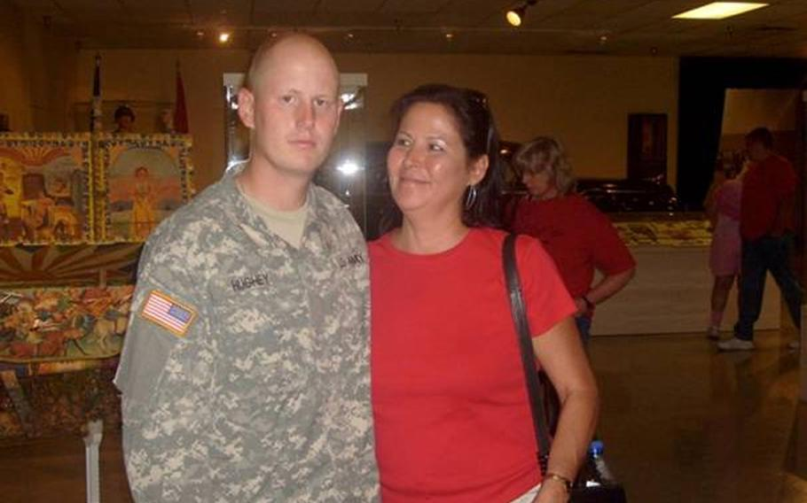 Jonathan with his Mom, Jeanette Baker, after graduating from basic training.