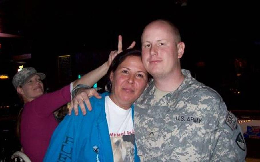 Jonathan with his mom at their favorite bar during a visit home from Fort Hood, Texas.