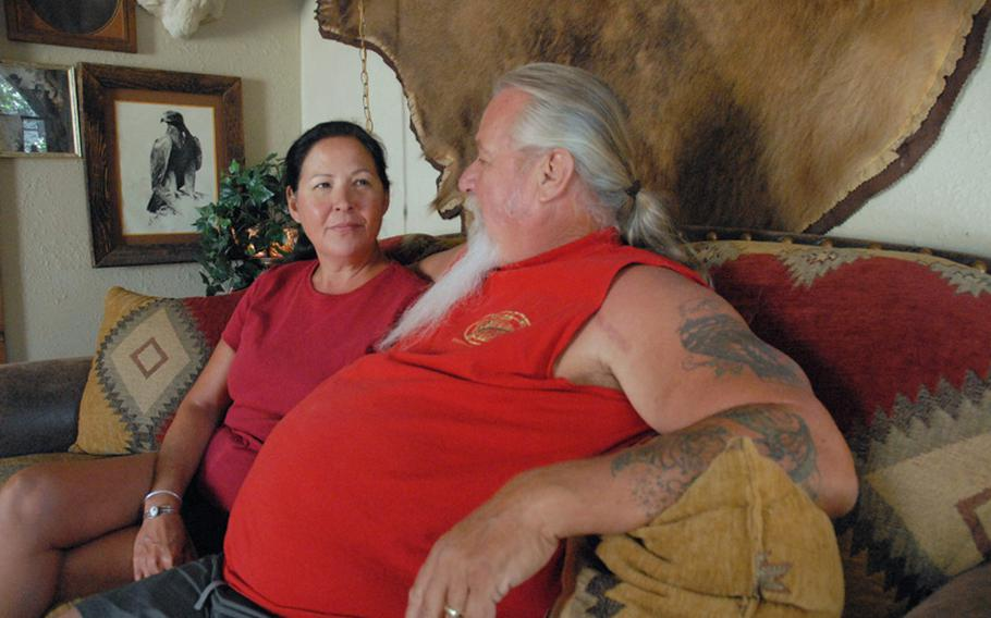 Jeanette and John Baker, sitting in their Phoenix home, have spent 2010 asking why their son, Sgt. Jonathan Hughey, killed himself on New Year's Day.