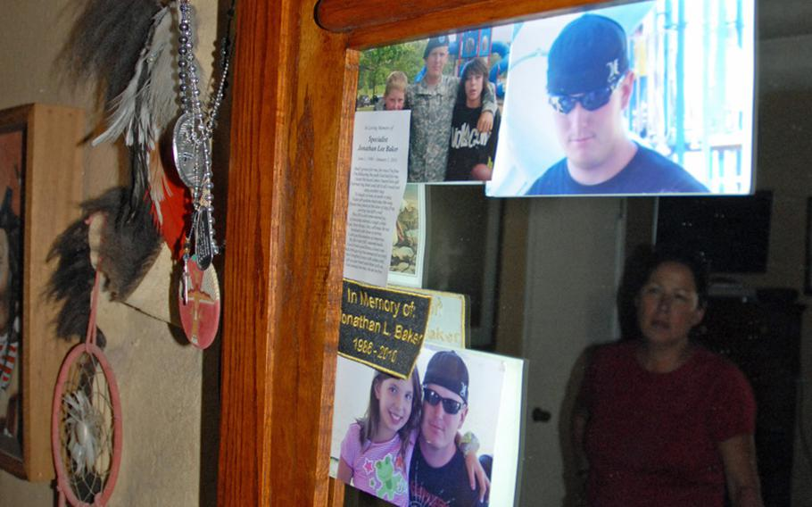 The mirror in Jeanette and John Baker's bedroom is decorated with photos of Spc. Jonathan Hughey. Jeanette occasionally rubs his dog tags, which also hang from the mirror.