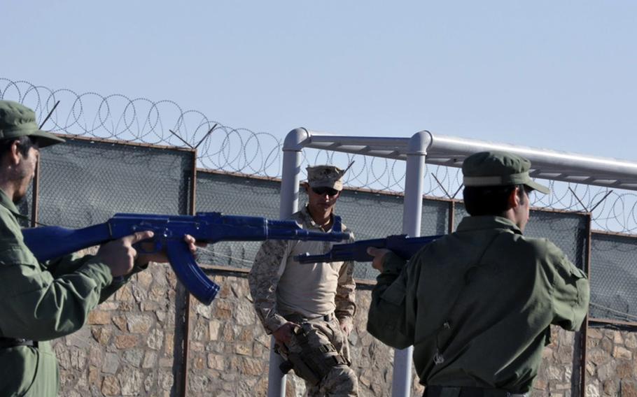 Marine Lance Cpl. John White oversees an Afghan police training session Nov. 13 at the Adraskan National Training Center.