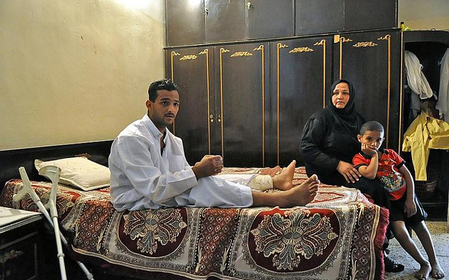 Fadel Nathem, was the equivalent of a specialist in the Iraqi army when he was wounded by a suicide car bomber in September 2008. With him in the room where he lives is his mother Yasra Abd Ali, his main caretaker, and his youngest brother.