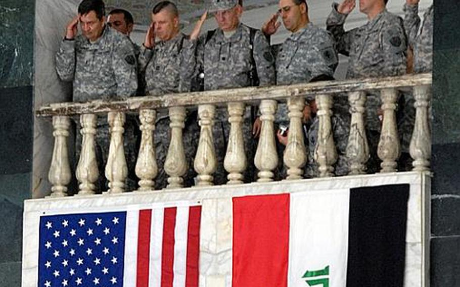 U.S. troops salute during the Iraqi national anthem at the beginning of the ceremony signaling the end of Operation Iraqi Freedom and the beginning of Operation New Dawn on Sept. 1, in Baghdad.
