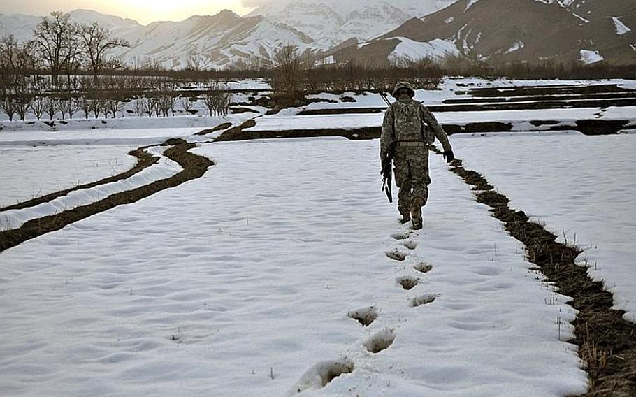 Capt. Kirby Jones slogs through the snow during a mission in the town of Khanjankhel in Wardak province. Jones, of Bellingham, Wash., has almost completely abandoned using vehicles for his company's patrols, opting to walk, often across farm field, to minimize the threat of roadside bombs.