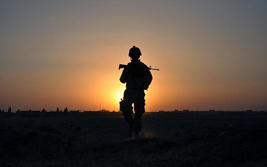 An American soldier patrols at sunset outside of Mosul. With operations winding down in Iraq, veterans of the long war hope their sacrifice translate into a successful country.