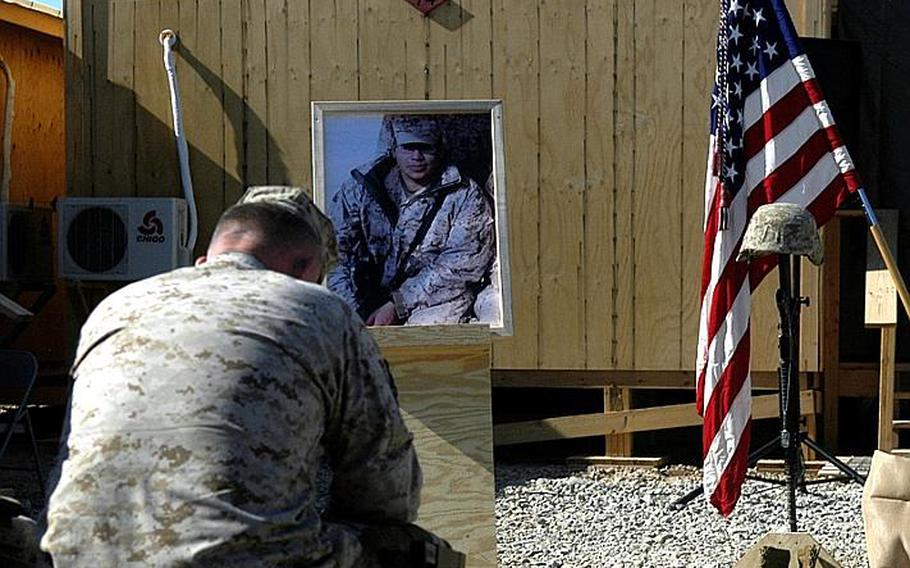 Brig. Gen. Larry Nicholson, commander of Marine Expeditionary Brigade-Afghanistan, mourns during a memorial for Lance Cpl. Mark Juarez, on Jan. 19.