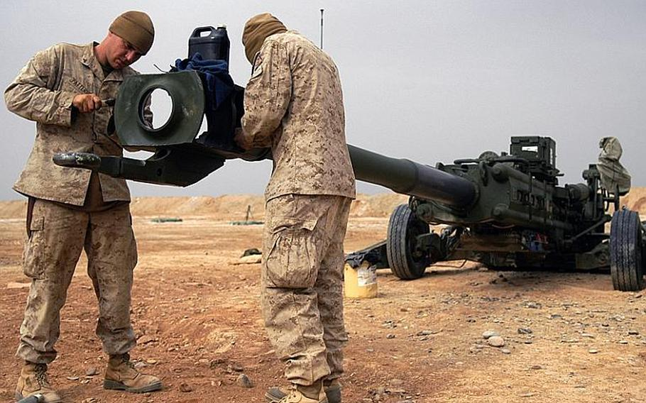 Lance Cpl. Jacob Patterson, left, and Lance Cpl. Richard Helsley, keep their howitzer clean and ready in case a call comes in for fire support.