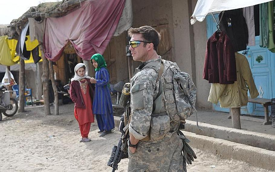 Staff Sgt. Chris Hand walks in the Bala Murghab bazaar on Feb. 19. Coalition and Afghan forces fought together to push insurgents from the bazaar in Badghis province in early November.