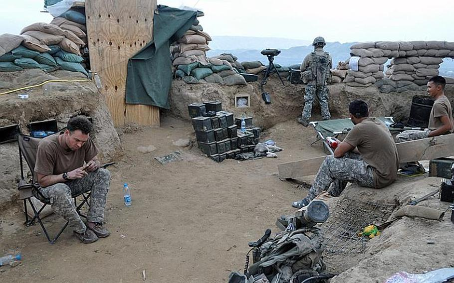 U.S. forces kick back during some down time at Objective Pathfinder in Bala Murghab province on Feb. 19. Coalition and Afghan forces captured the strategic position from insurgents in December and live jointly in the fort dug into the hilltop.
