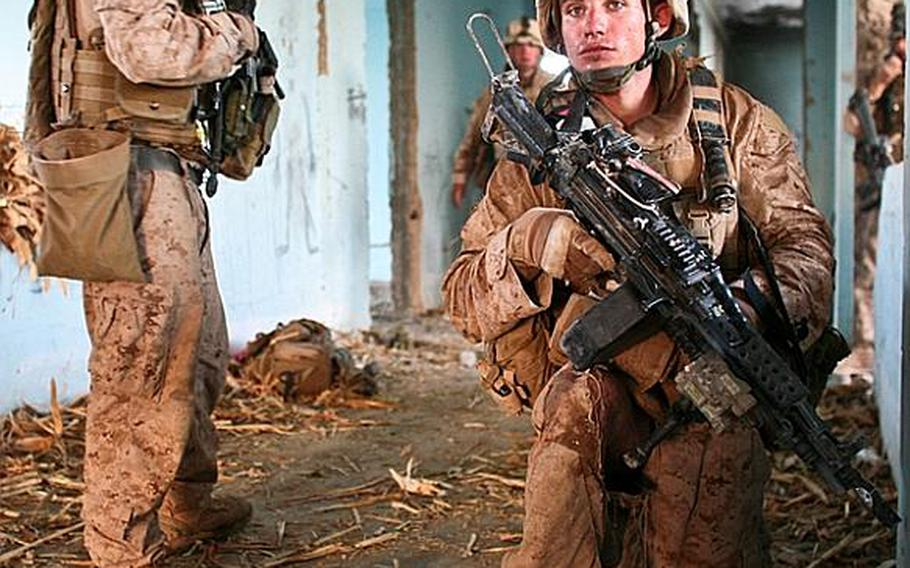 The Taliban have broken off their attack within the first 20 minutes, but as tired and ragged Marines filter in from the patrol, they take up defensive positions inside the building, in case the fighters decide to strike again.