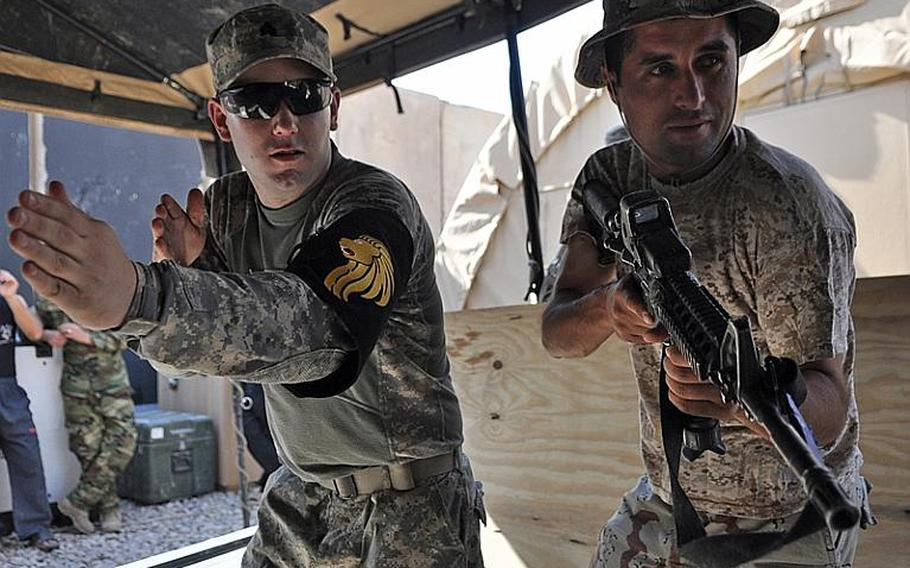 Sgt. Ryan Carlson, left, shows an Iraqi soldier how to raid a home at Checkpoint 3, a small base outside Mosul in August. Training the Iraqi security forces will be key as the U.S. nears the 2011 deadline to withdraw all troops.