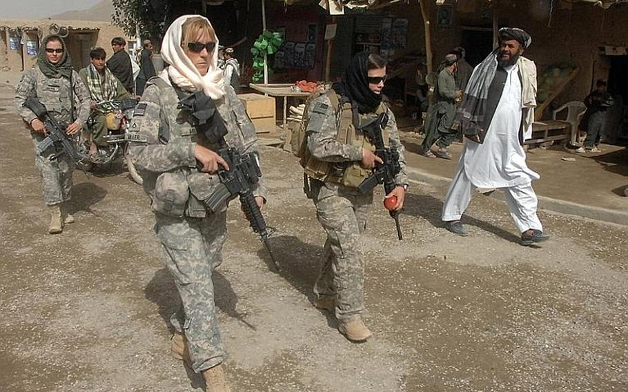 Female Engagement Team members Pfc. Kelly Shutka, 22, of Pine Glen, Pa., Pfc. Rachel Miller, 39, of Northumberland, Pa., and Sgt. Richelle Aus, 25, of Michigan City, Ind., patrol through a bazaar in Zabul province.