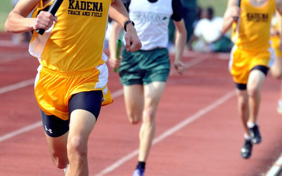 Tomas Sanchez of Kadena leads the pack toward the finish line of the 3,200-meter relay during Friday's Okinawa Activities Council weekly quadrangular track and field meet at Camp Foster, Okinawa. Kadena's A team won the relay in 8 minutes, 59.14 seconds.