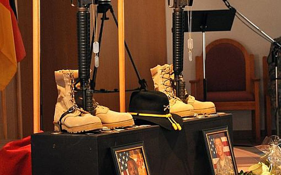 A memorial at the Cavalry Chapel on Rose Barracks honors Cpl. Donald R. Mickler Jr. and Pfc. Rudy A. Acosta in Vilseck, German, on Thursday. Both soldiers were killed March 19 in Afghanistan. They were posthumously promoted.