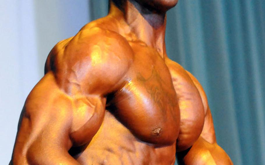 Men's bantamweight champion Marcus Caudle in Sunday's 5th Pacific Muscle Classic bodybuilding, fitness and figure competition at Keystone Theater, Kadena Air Base, Okinawa.