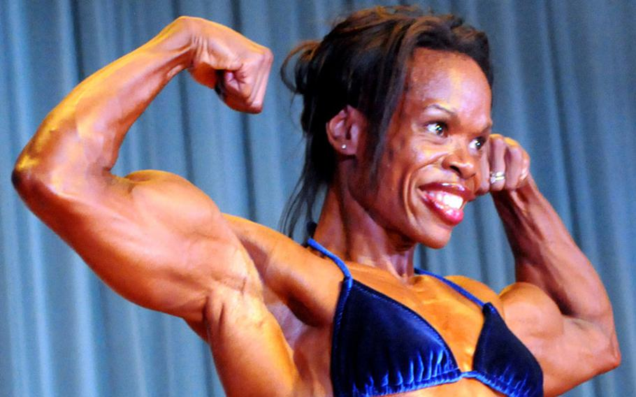 'Women's heavyweight and overall champion and Best Poser award winner Tamara Dickey in Sunday's 5th Pacific Muscle Classic bodybuilding, fitness and figure competition at Keystone Theater, Kadena Air Base, Okinawa.