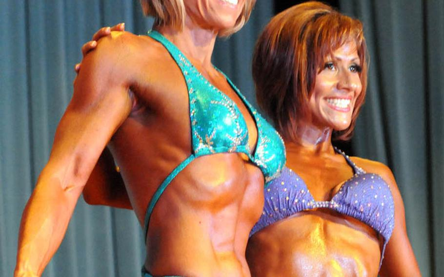Women's figure champions, 5-foot-3 and over Stacy Tews and 5-3 and under and overall winner Ivette Kragel in Sunday's 5th Pacific Muscle Classic bodybuilding, fitness and figure competition at Keystone Theater, Kadena Air Base, Okinawa.