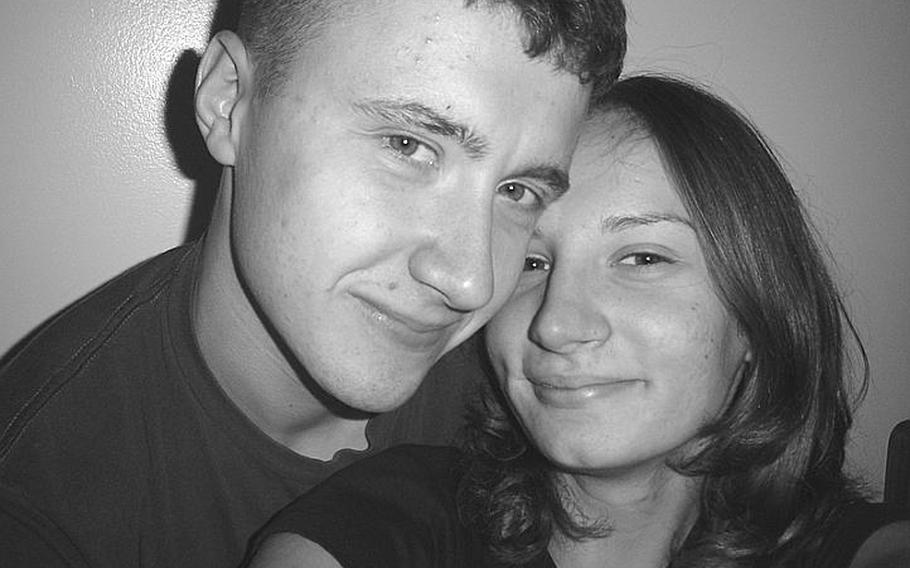 Yuriy and Aimee Zmysly reunite during a 2005 homecoming from Iraq. The following year Yuriy Zmysly, a Marine, would be stricken with brain damage due to medical mistakes made at a military hospital in Cherry Point, N.C.