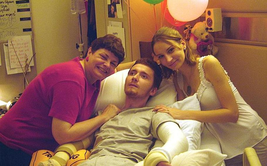 Yuriy Zmysly, a former Marine, celebrates his 22nd birthday after waking up from a three-month coma in a Chicago hospital. His wife Aimee Zmysly, right, said he was stricken with brain damage due to medical mistakes made at a military hospital in Cherry Point, N.C.
