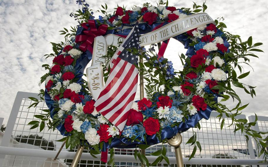 A wreath is displayed at the foot of the Space Mirror Memorial at the Kennedy Space Center Visitor Complex in Florida during a ceremony to honor space shuttle Challenger's crew members.