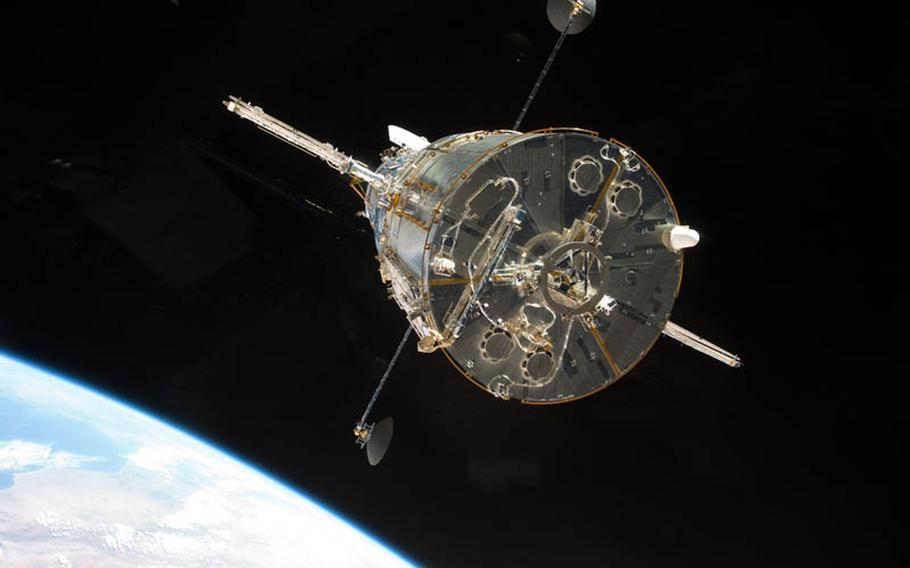 The STS-125 crew aboard space shuttle Atlantis captured this still image of the Hubble Space Telescope as the two spacecraft begin their relative separation on May 19, 2009, after having been linked together for nearly a week. During the week, five spacewalks were performed to complete the final servicing mission to the telescope.