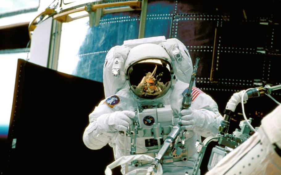 Astronaut Steve Smith works on Hubble during the second servicing mission in 1997, using a specially designed tool that can withstand the harsh environment of space. Hubble was specifically built to be serviced in orbit with replaceable parts and instruments.