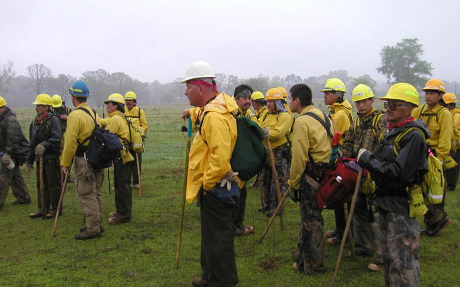 Members of a search team scour the land looking for remnants of the shuttle Columbia after it burned up on re-entry in 2003.