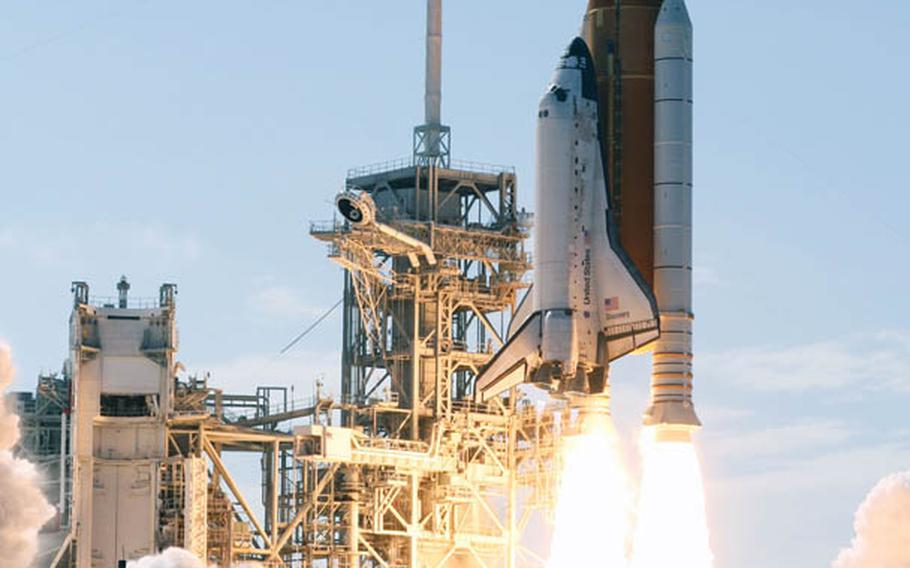 The Space Shuttle Discovery and its seven-member crew head toward orbit and a scheduled link-up with the International Space Station after this May 2008 launch.