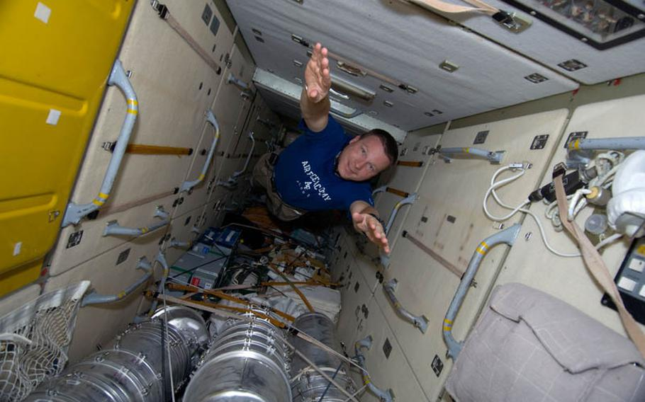 NASA astronaut Terry Virts floats through the Zarya Functional Cargo Block of the International Space Station while space shuttle Endeavour was docked with the station in February 2010.