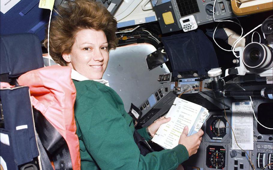 Eileen Collins, commander on 1999 ''return to flight,'' goes through a checklist in zero gravity.