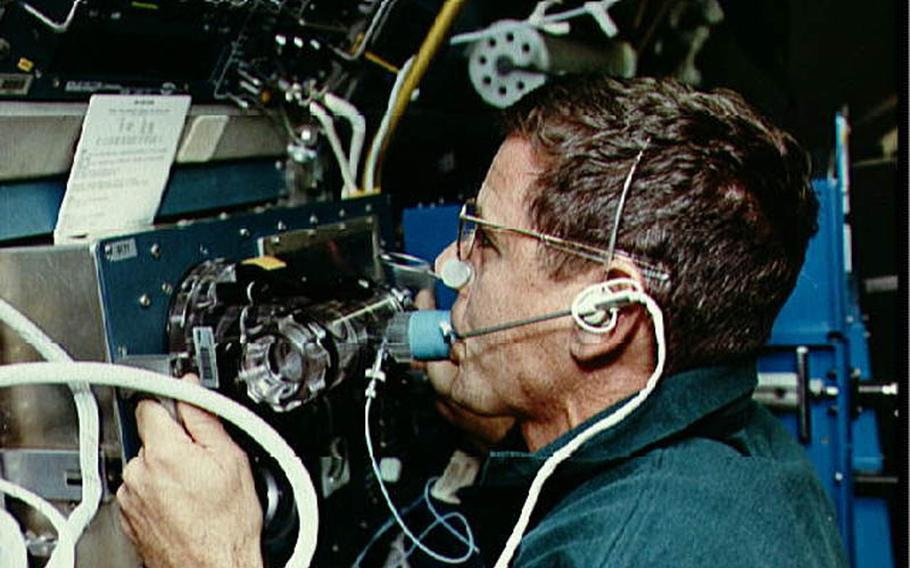 During a 1993 space shuttle flight, astronaut William ''Bill'' McArthur uses a rebreather in an experiment measuring how gases distribute through the blood while in space.