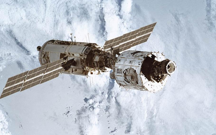Shuttle astronauts joined a Russian module, left, to an American one, right, to begin assembly of the International Space Station.