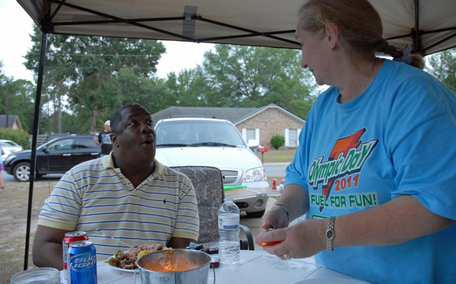 Maj. Shabon Shelton and Janet Gladwell talk at a barbeque at Gladwell's house by Fort Stewart, Ga. The two have formed an unlikely friendship. Gladwell's son, former Army Sgt. Robert Quinones, held Shelton hostage last September at Fort Stewart's hospital. Shelton is trying to help Quinones get treatment for his Post Traumatic Stress Disorder.