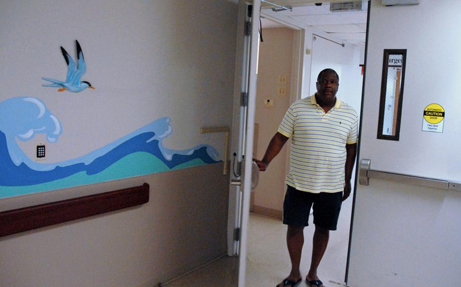 Maj. Shabon Shelton, a psychiatric nurse, walks out the same doors on the third floor of Fort Benning's hospital that he did on Sept. 6, 2010, when he entered a hostage situation to try to calm down retired Army Sgt. Robert Quinones. Quinones had entered the hospital with four guns, demanding mental health treatment.