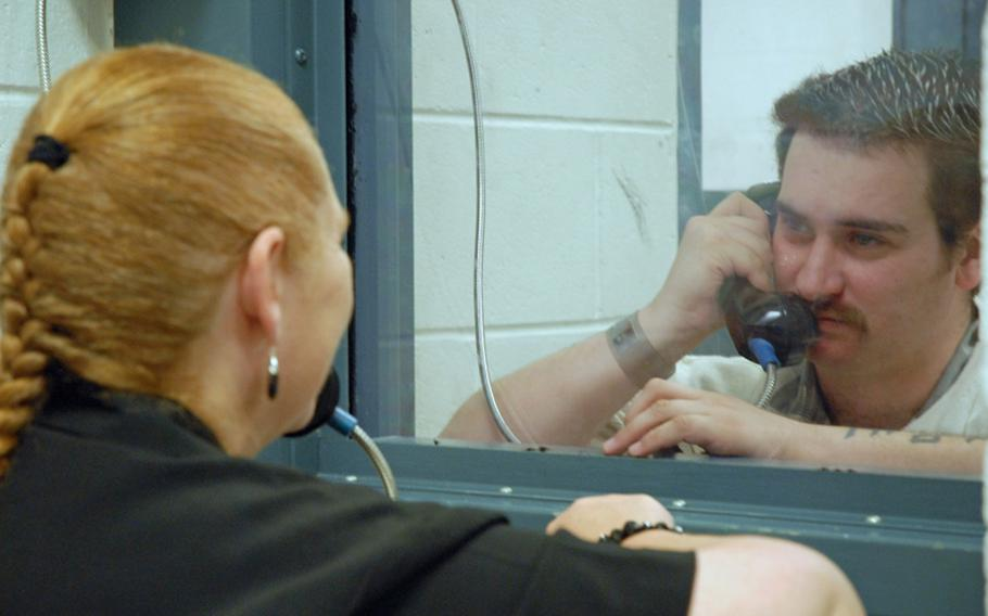 Former Army Sgt. Robert Quinones talks to his mom, Janet Gladwell, during weekly visiting hours at a county jail in Statesboro, Ga. Quinones is being held for going into the hospital on nearby Fort Stewart and holding three soldiers hostage in September 2010.