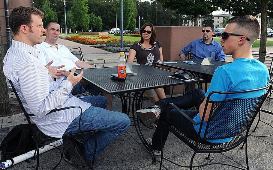 Jason Torpy, the president of Military Association of Atheists and Freethinkers, left, talks to members of the Kaiserslautern military community's branch, from left Kevin Kennedy, Rene Noel, Clint Rasic and Jared Ducker, at a recent meeting.