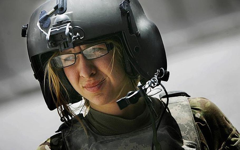 Flight medic Cpl. Amanda Mosher, of the 563rd Aviation Support Battalion, 159th Combat Aviation Brigade, 101st Airborne Division, pauses after a mission on June 15, 2011, at Forward Operation Base Pasab in Afghanistan.