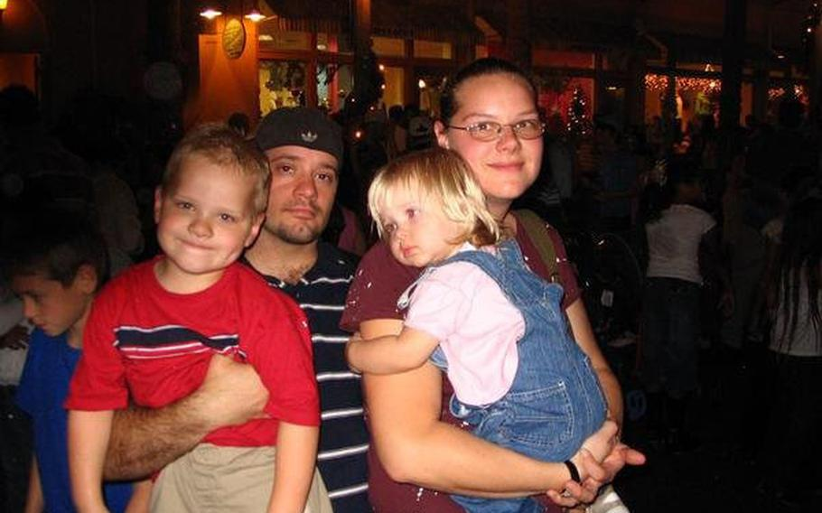 Nekl Allen and his wife, Amy, pose with their children Michael and Grace during a 2007 trip to Florida.