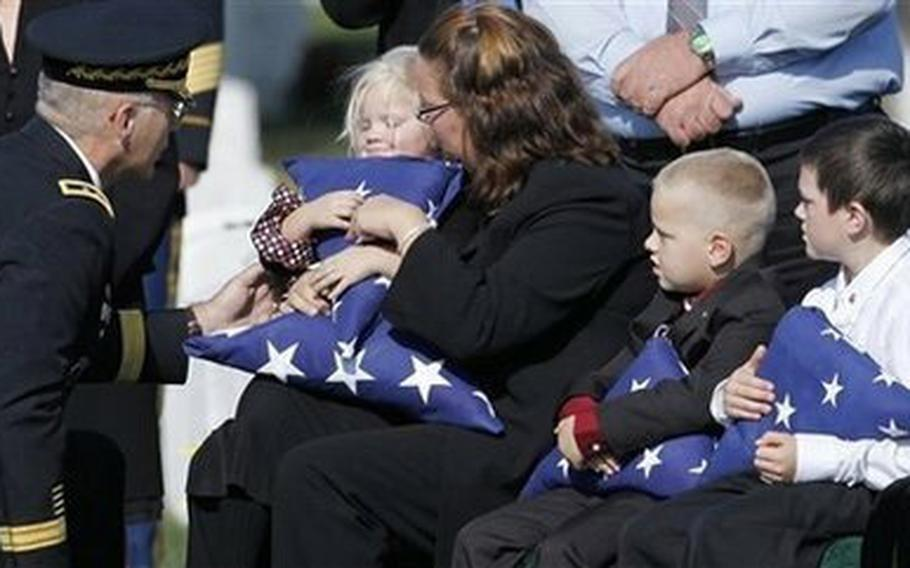 The family of Staff Sgt. Nekl Allen is presented with folded American flags at his funeral in 2009. Allen, who joined the Army in response to the 9/11 attacks, was killed when a bomb exploded beneath his vehicle in Afghanistan.
