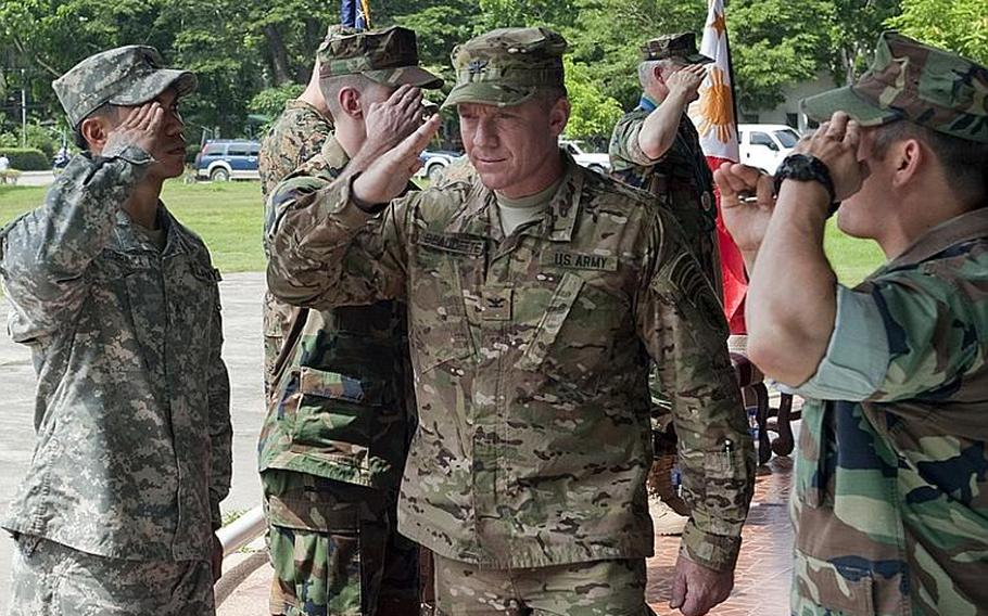 U.S. Navy Capt. Robert V. Gusentine, Commander, Joint Special Operations Task Force - Philippines (JSOTF-P) relinquished command to U.S. Army Col. Fran Beaudette during a change of command ceremony held at Camp Navarro, Western Mindanao Command June 24.