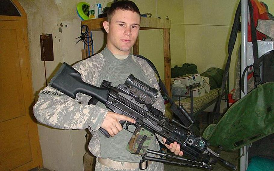 David Kaefring, posing with an M249 Squad Automatic Weapon in Afghanistan in 2009, was a freshman in high school on September 11, 2001.