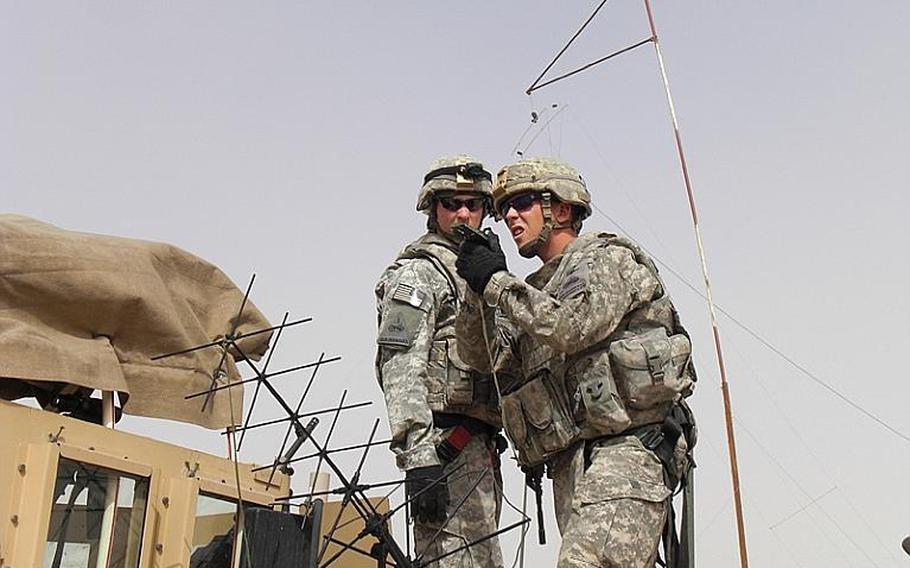 Sgt. James Coleman sets up communications equipment in Afghanistan during his fourth deployment.