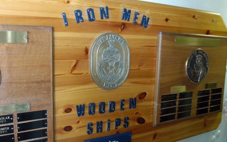 Despite enormous strides made by women in the Navy in the past 20 years, crewing a mine countermeasures ship remains one of the last positions to be integrated. Lt. Cmdr. Suzanne Schang of the USS Patriot is one of the first women to rise to command a forward deployed mine ship. A plaque outside her quarters recognizing the ship's top sailors shows the culture that many women need to overcome.